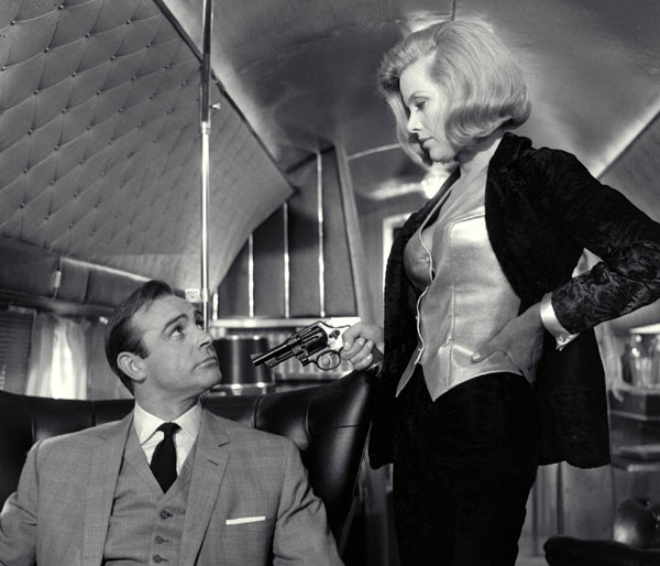 Goldfinger's Pilot Pussy Galore (Honor Blackman) & Bond (Sean Connery) © 1964 Danjaq, LLC & United Artists Corporation. All rights reserved