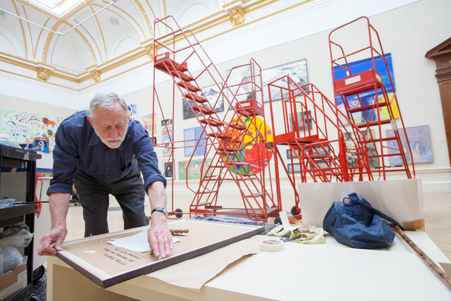 Peter Freeth RA, installing the Summer exhibition 2013. Photo: Benedict Johnson