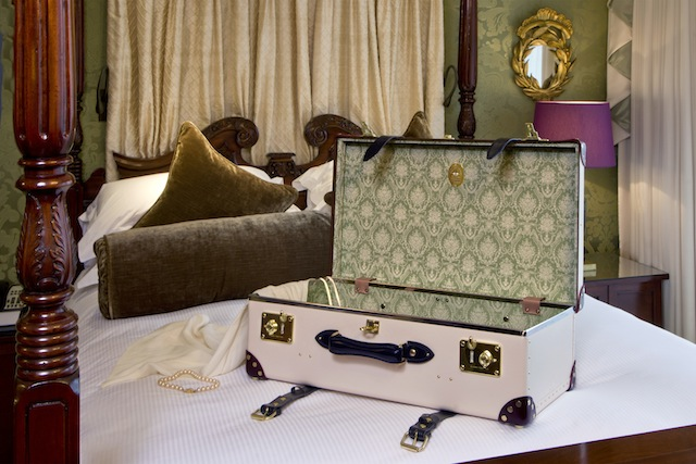 The-Globe-Trotter-Goring-Hotel-Edition_open-wiht-dress-on-bed_landscape_hi-res